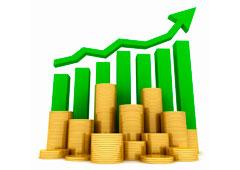 Una flecha verde ascendente y monedas