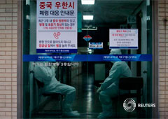 Medical workers stand by at a hospital in Daegu, South Korea, February 23, 2020.