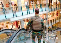 Belgian soldiers patrol the shopping center City2 in central Brussels, Belgium June 15, 2016