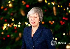 La primera ministra Theresa May habla en el 10 de Downing Street tras una moción de censura de parlamentarios conservadores en Londres, el 12 de diciembre de 2018
