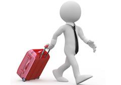 Un muñequito blanco con una maleta