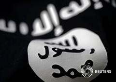 Ilustración fotográfica realizada en Sarajevo de una bandera del Estado Islámico, el 18 de febrero de 2016