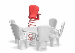 Una mesa redonda rodeada de sillas con muelles