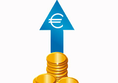 Monedas de euro y una flecha hacia arriba