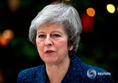 La primera ministra británica, Theresa May, a la salida de Downing Street tras el anuncio de la moción de censura contra su mandato, Londres, Reino Unido, 12 de diciembre de 2018