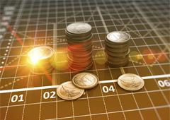 Monedas de euros sobre gráfico