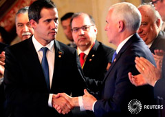 U.S. Vice President Mike Pence and Venezuelan opposition leader Juan Guaido, who many nations have recognized as the country's rightful interim ruler, shake hands during a meeting of the Lima Group in Bogota, Colombia, February 25, 2019.