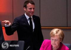 La canciller alemana Angela Merkel y el presidente francés Emmanuel Macron participan de una cumbre europea en Bruselas. 28 de mayo de 2019.