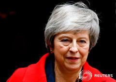 La primera ministra británica, Theresa May, a las afueras de su oficina y residencia oficial en Londres, dic 4, 2018.