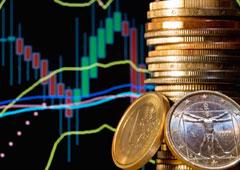 Monedas sobre un fondo con gráficos de colores
