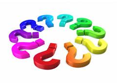Un círculo formado por signos de interrogación de varios colores.
