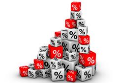 Varios cubos rojos y blancos con el símbolo %