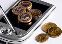 Monedas sobre un móvil