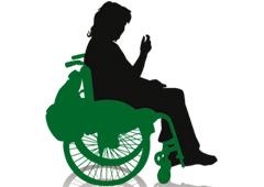 Silueta de una mujer en una silla de ruedas