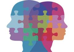 Dos cabezas hechas de fichas de puzle