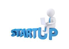 Un muñequito blanco sentado encima de la palabra startup